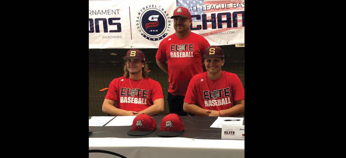 Brayden Patterson and Josh Davis sign to play baseball. Pictured with them is Chad Webb.