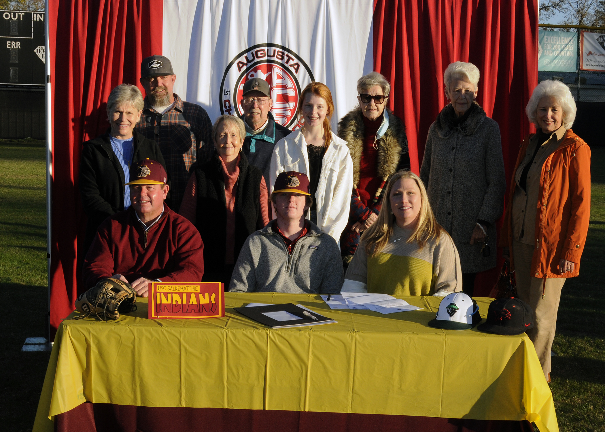 Hugh Signs to Play Baseball